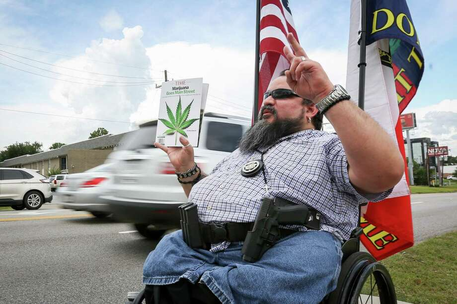 Willis resident Mark Garza participates in the Cannabis Open Carry Walk on Saturday, Aug. 4, 2018, off of North Loop 336 in Conroe. Photo: Michael Minasi, Staff Photographer / Houston Chronicle / © 2018 Houston Chronicle
