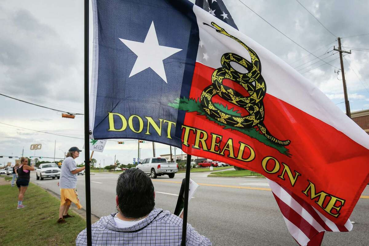 A flag that mixes the Texas state flag with the Don't Tread On Me flag is pictured during the Cannabis Open Carry Walk on Saturday, Aug. 4, 2018, off of North Loop 336 in Conroe.
