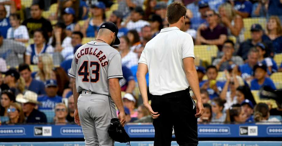 LOS ANGELES, CA - AUGUST 04: Lance McCullers Jr. #43 of the Houston Astros walks off the field with medical personnel as he leaves the game with an injury at the start of the fifth inning against the Los Angeles Dodgers at Dodger Stadium on August 4, 2018 in Los Angeles, California. (Photo by Jayne Kamin-Oncea/Getty Images) Photo: Jayne Kamin-Oncea/Getty Images