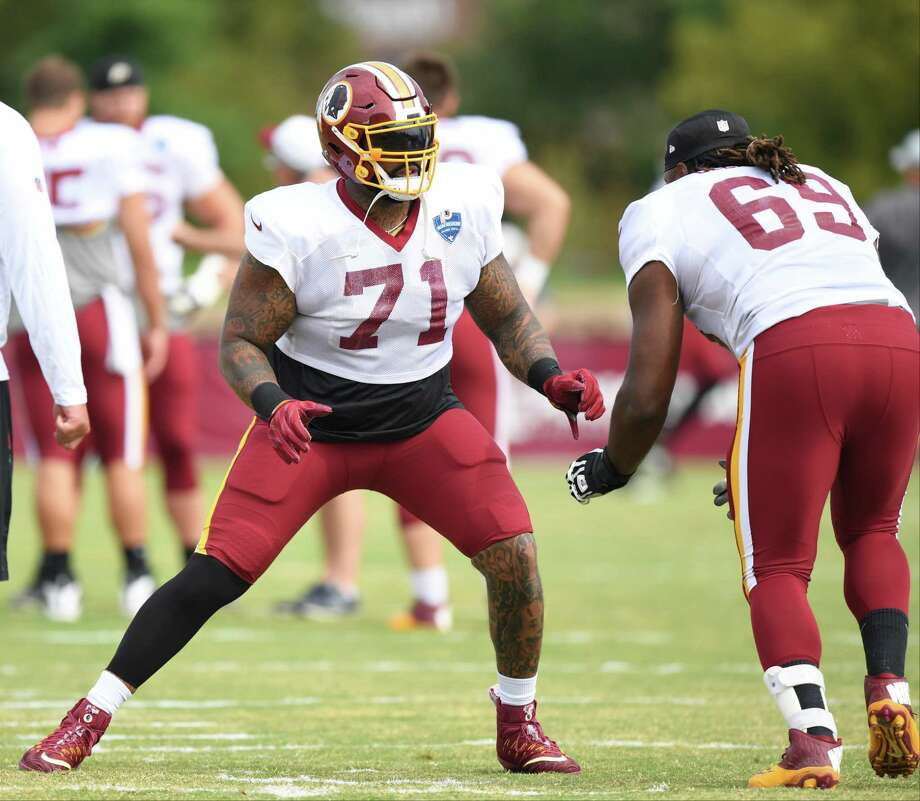 Washington Redskins offensive tackle Trent Williams (71) works on technique with tackle T.J. Clemmings (69) during training camp. Photo: Washington Post Photo By Jonathan Newton / The Washington Post
