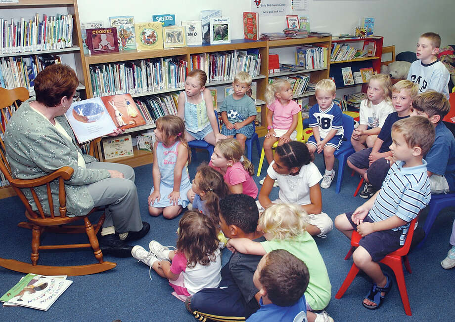 """Grandma Beth"" Schondorf of East Haddam reads to a group of children in the East Haddam Public Library on Thursday...........TW photo Photo: Middletown Press File Photo"