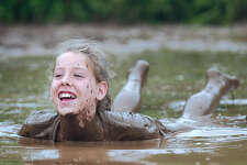 Moriah Arabas, 11, of Middletown soaks in the mud at Zoars Pond Saturday between matches at the 18th Annual Mud Volleyball Tournament to benefit the Epilepsy Foundation of Connecticut. The event raised an anticipated $25,000 for the foundation. This annual tournament is the foundation's largest single fundraiser.......J. Rossi photo.......08.21.04.