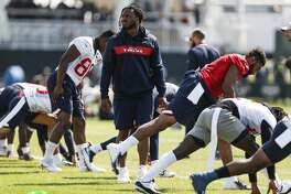 Houston Texans running back D'Onta Foreman walks on the field as his teammates warm up during training camp at the Greenbrier Sports Performance Center on Sunday, Aug. 5, 2018, in White Sulphur Springs, W.Va. Foreman is still recovering from an achilles injury, suffered last season.