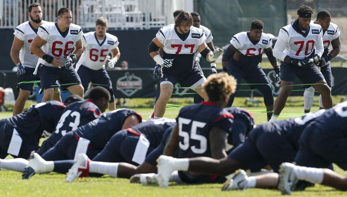 Houston Texans players stretch during training camp at the Greenbrier Sports Performance Center on Sunday, Aug. 5, 2018, in White Sulphur Springs, W.Va.