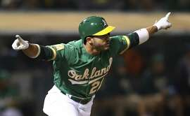 Oakland Athletics' Ramon Laureano celebrates after making the game winning hit against the Detroit Tigers in the 13th inning of a baseball game Friday, Aug. 3, 2018, in Oakland, Calif. (AP Photo/Ben Margot)