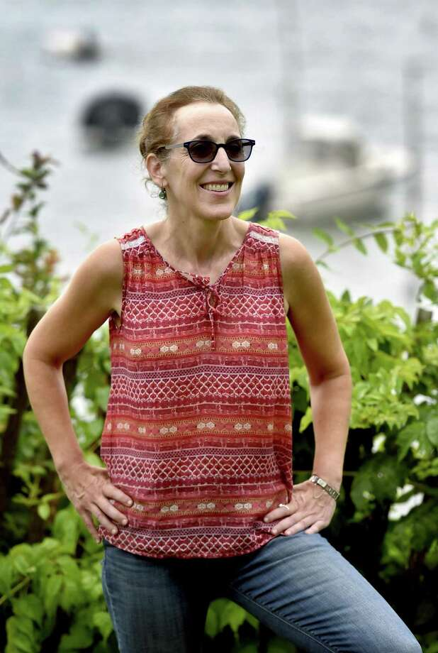 Freelance writer Lisa Reisman of Branford, a 20-year survivor of glioblastoma, at her home last week. Photo: Peter Hvizdak / Hearst Connecticut Media / New Haven Register