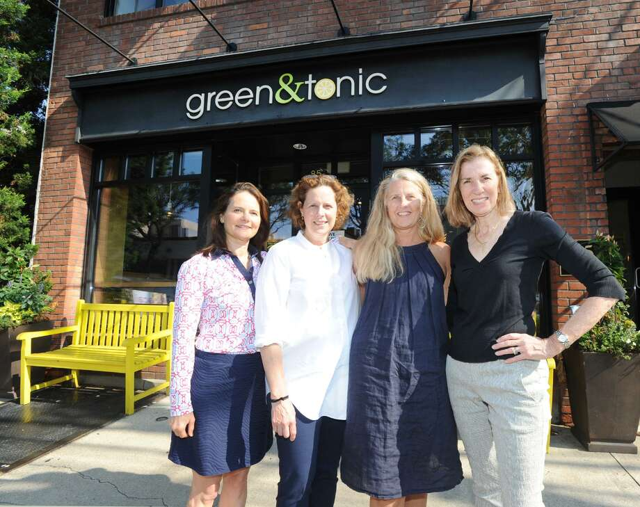 Greenwich residents and environmentalists from left to right, Hillary McAtee, Claire Werner, Jeanine Behr Getz and Mary Shaw Marks outside the Green & Tonic Restaurant on Railroad Avenue in Greenwich, Conn., Friday, July 27, 2018. The women are backing a plastic straw ban and they say that the Green & Tonic Restaurant is participating by now offering environmental friendly paper straws. Photo: Bob Luckey Jr. / Hearst Connecticut Media / Greenwich Time