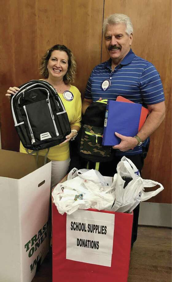 CHS Leo Club Liaisons Stacey Jata, left, and Rick Camp, right, box up the school supplies collected by Conroe Noon Lions Club as part of the Texas Leo Clubs initiative 'Pack the Back'. The CHS Leo Club will fill and distribute over 70 backpacks for children this school year.