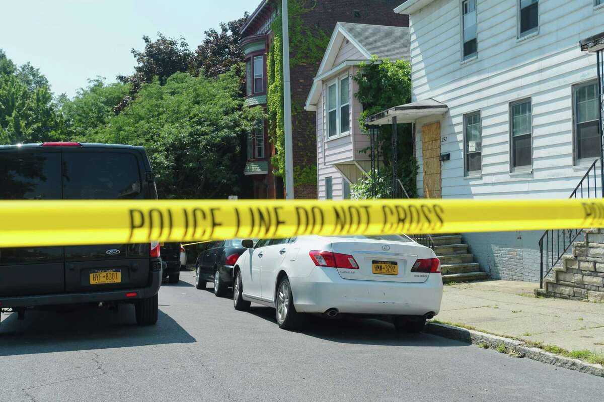 Police vehicles are seen at the scene of a shooting on Remsen Street on Sunday, Aug. 5, 2018, in Cohoes, N.Y. (Paul Buckowski/Times Union)