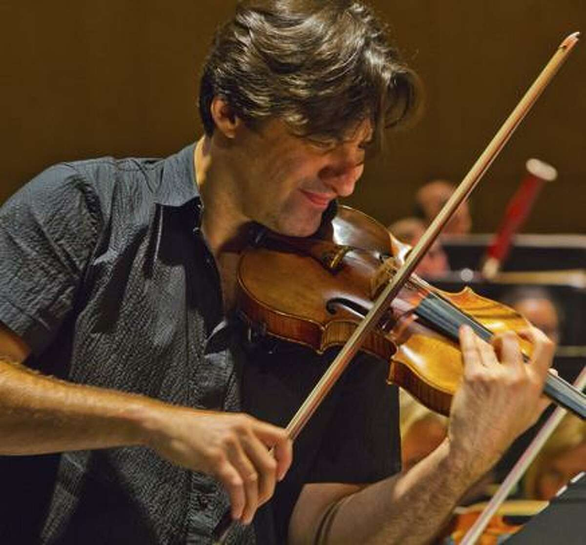 Philippe Quint played violin with a soulful suaveness.