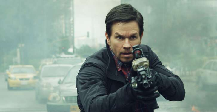 "This cover image released by STXfilms shows Mark Wahlberg in a scene from ""Mile 22."" (STXfilms via AP)"