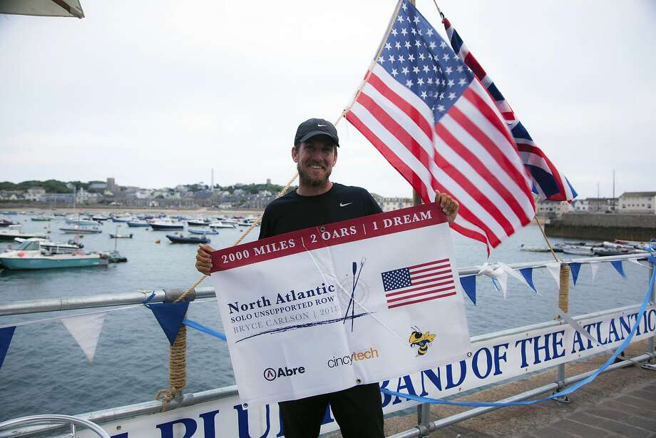 In this Saturday, Aug. 4, 2018 photo provided by Bryce Carlson Adventures, Bryce Carlson poses for a photo after completing his solo unsupported row across the Atlantic, at St Mary's Harbour, Isle of Scilly, England. A high school science teacher from Cincinnati, Ohio, has rowed solo across the Atlantic, setting a record for a west-to-east crossing.  Carlson arrived at St. Mary's in the Scilly Isles, off England's southwestern tip, late Saturday _ 38 days, six hours and 49 minutes after setting out from St. John's, Newfoundland. (Bryce Carlson Adventures via AP) Photo: Associated Press