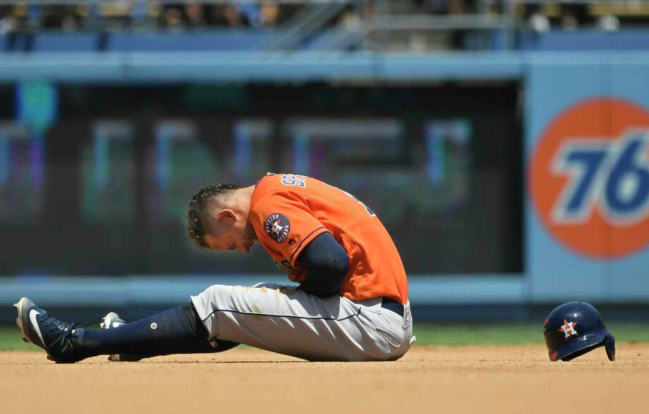 LOS ANGELES, CA - AUGUST 05: George Springer #4 of the Houston Astros reacts to being injured after getting caught trying to steal second base in the third inning against the Los Angeles Dodgers at Dodger Stadium on August 5, 2018 in Los Angeles, California. Photo: John McCoy, Getty Images / 2018 Getty Images