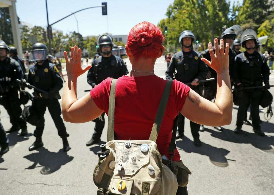 A counterprotester is stopped by Berkeley police just north of a gathering of the Proud Boys, a conservative group. Photo: Scott Strazzante / The Chronicle / San Francisco Chronicle