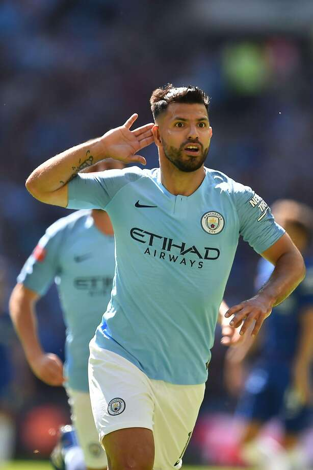 Manchester City's Sergio basks in applause after scoring the first of two goals. Photo: Glyn Kirk / AFP / Getty Images