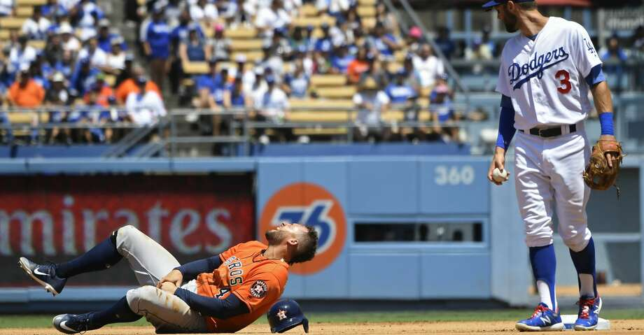 LOS ANGELES, CA - AUGUST 05: George Springer #4 of the Houston Astros reacts to an injury after being caught stealing at second base by Chris Taylor #3 of the Los Angeles Dodgers in the thrid inning at Dodger Stadium on August 5, 2018 in Los Angeles, California. (Photo by John McCoy/Getty Images) Photo: John McCoy/Getty Images