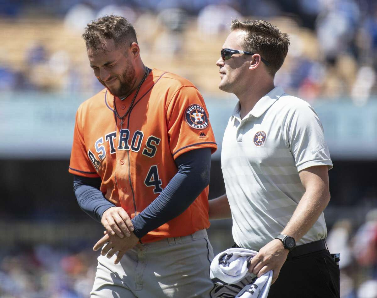 Houston Astros' George Springer, left, exits with a trainer after getting injured whiletrying to steal second base during the third inning of a baseball game against the Los Angeles Dodgers in Los Angeles, Sunday, Aug. 5, 2018. (AP Photo/Kyusung Gong) PHOTOS: What we know about Roberto Osuna, the Astros' newest reliever.