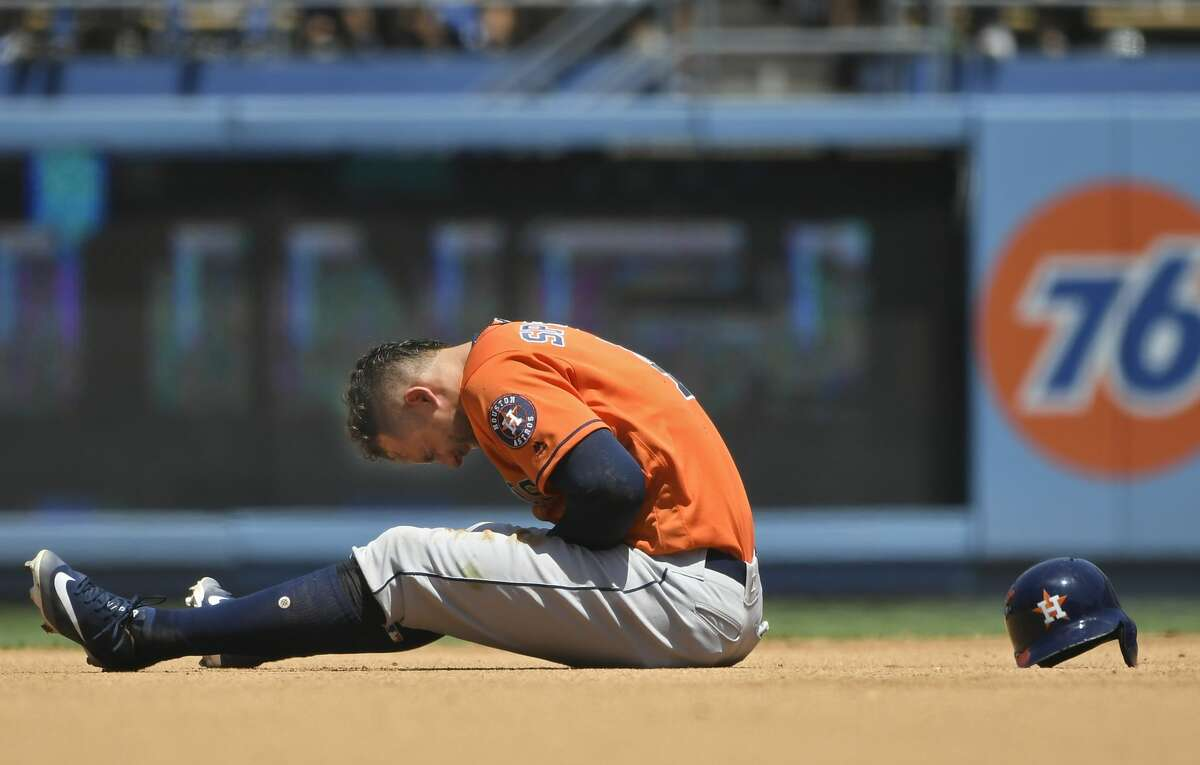 LOS ANGELES, CA - AUGUST 05: George Springer #4 of the Houston Astros reacts to being injured after getting caught trying to steal second base in the third inning against the Los Angeles Dodgers at Dodger Stadium on August 5, 2018 in Los Angeles, California. (Photo by John McCoy/Getty Images)