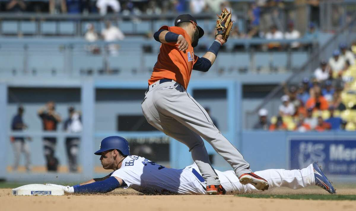 LOS ANGELES, CA - AUGUST 05: Corey Seager #5 of the Los Angeles Dodgers steals second base before Marwin Gonzalez #9 of the Houston Astros can make the tag in the eighth inning at Dodger Stadium on August 5, 2018 in Los Angeles, California. (Photo by John McCoy/Getty Images)