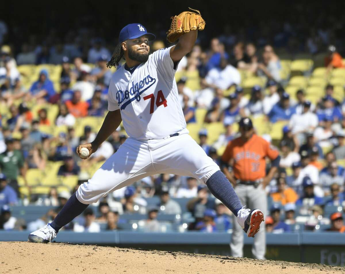 LOS ANGELES, CA - AUGUST 05: Kenley Jansen #74 of the Los Angeles Dodgers pitches against the Houston Astros in the ninth inning at Dodger Stadium on August 5, 2018 in Los Angeles, California. (Photo by John McCoy/Getty Images)