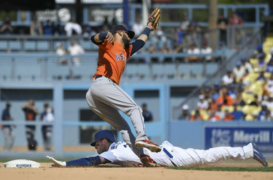 LOS ANGELES, CA - AUGUST 05: Corey Seager #5 of the Los Angeles Dodgers steals second base before Marwin Gonzalez #9 of the Houston Astros can make the tag in the eighth inning at Dodger Stadium on August 5, 2018 in Los Angeles, California. (Photo by John McCoy/Getty Images) Photo: John McCoy/Getty Images
