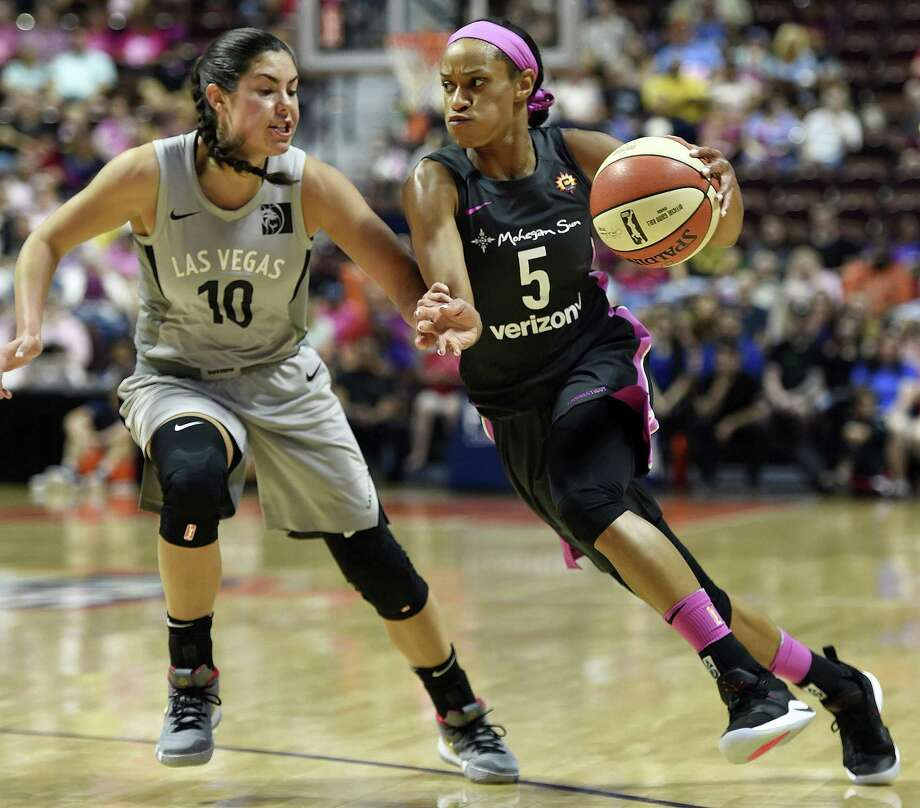 Connecticut Sun guard Jasmine Thomas (5) drives past Las Vegas Aces guard Kelsey Plum (10) in the first half half on Sunday in Uncasville. Photo: Sean D. Elliot / Associated Press / 2018 The Day Publishing Company