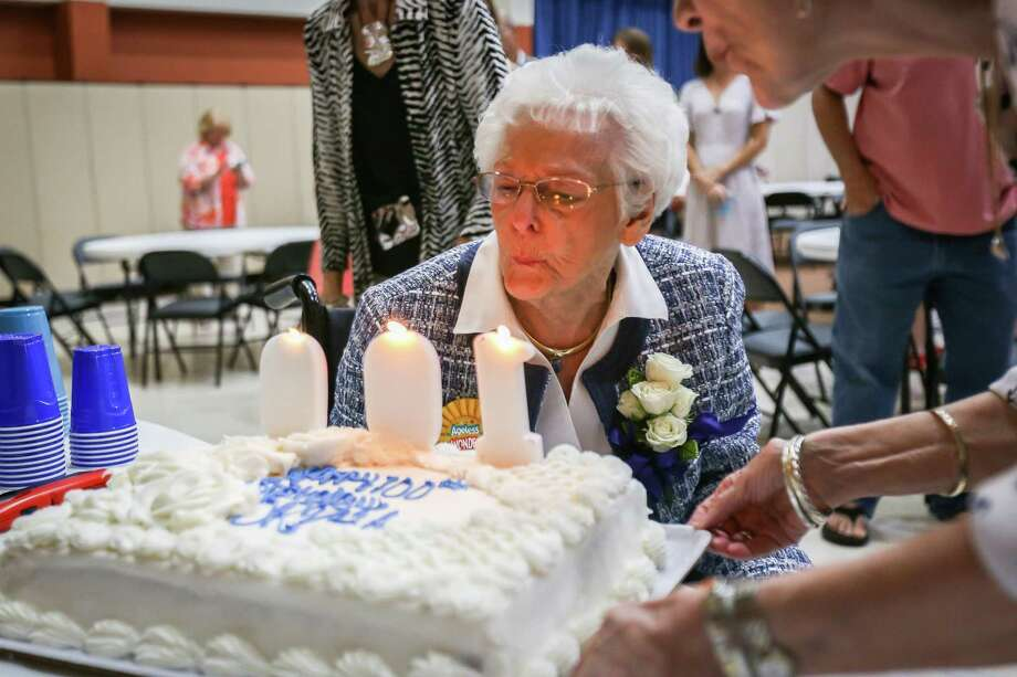 Orpha Edgar gets a little help blowing out candles during her 100th birthday celebration on Saturday, Aug. 4, 2018, at Grace Lutheran Church. Photo: Michael Minasi, Staff Photographer / Houston Chronicle / © 2018 Houston Chronicle