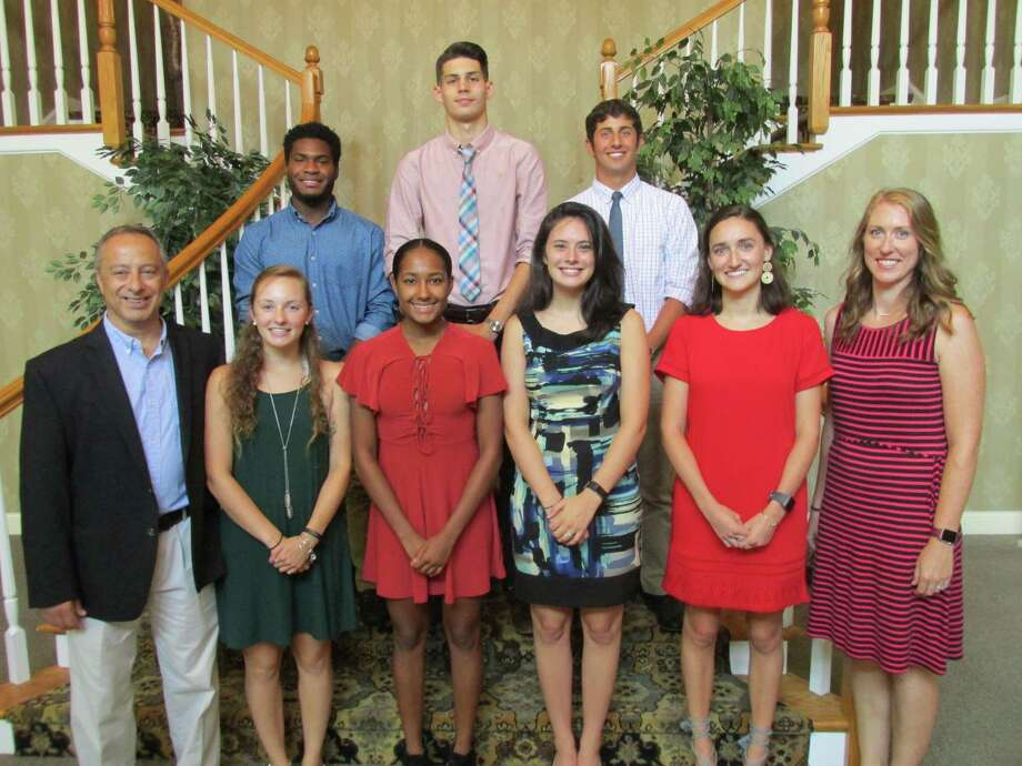This year's Varsity Alumni Club scholarship winners and officers are, front row, left to right: President Mario Longobucco, Cara Baker, Ariana Santos, Catherine Butrick, Anna Clinkscales, Vice President Christine Gamari. Second row, left to right: Dylan Myrie, Billy Cook, Billy Weber. Scholarship winner Cassie Fedor was unable to attend. Photo: Peter Wallace / For Hearst Connecticut Media