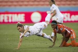 Houston Dash Linda Mothalo, right, (10) cringes after falling along with her opponent Utah Royals Lo'eau LaBonta (9) during the first half of the game at BBVA Stadium on Sunday, Aug. 5, 2018, in Houston.