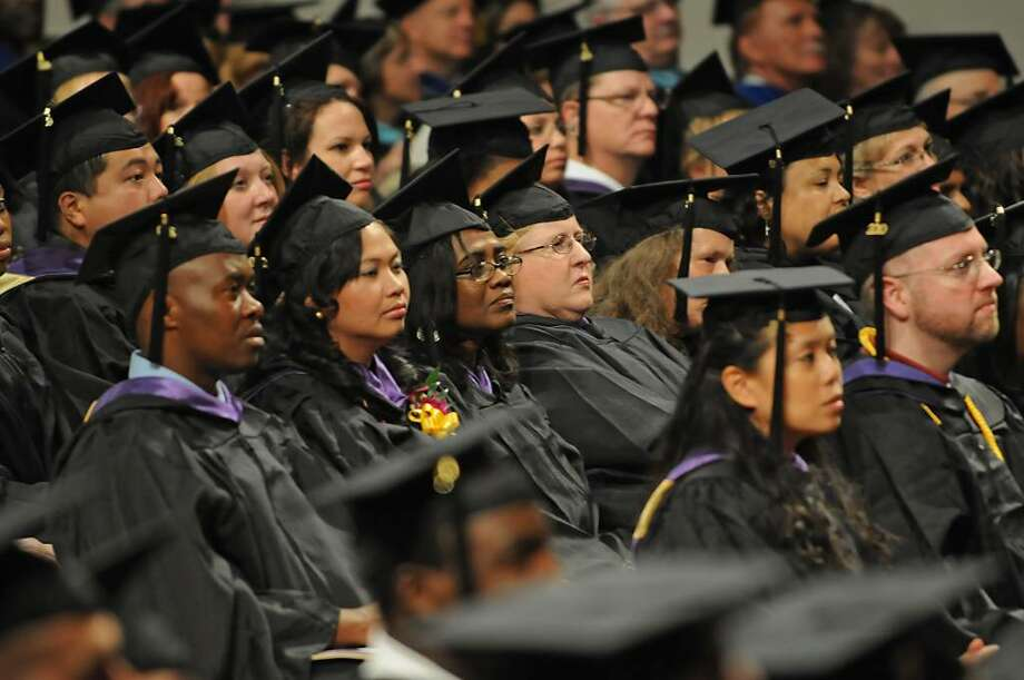 Graduates attend the Excelsior College 2010 commencement ceremony at the Empire State Plaza Convention Center in Albany on July 9.  (Lori Van Buren / Times Union) Photo: LORI VAN BUREN