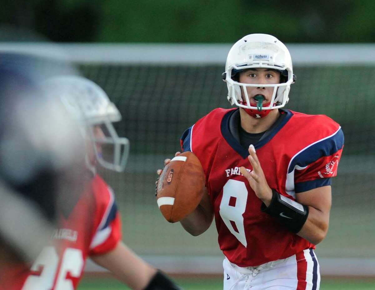 Mike Lefflbine, quarterback for the Fairfield County all-stars looks for an oprn receiver during the New Haven County vs. Fairfield County all-star high school football game Ken Strong Stadium, West Haven High School, Friday evening, July 9, 2010.