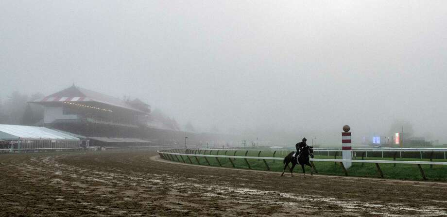 Early morning fog will give way to sun and humidity on Friday, Sept. 14, 2018. Fog returns to the Saratoga Race Course as horses go out for exercise this morning Sunday  Aug. 5, 2018 in Saratoga Springs, N.Y.(Skip Dickstein Photo: SKIP DICKSTEIN
