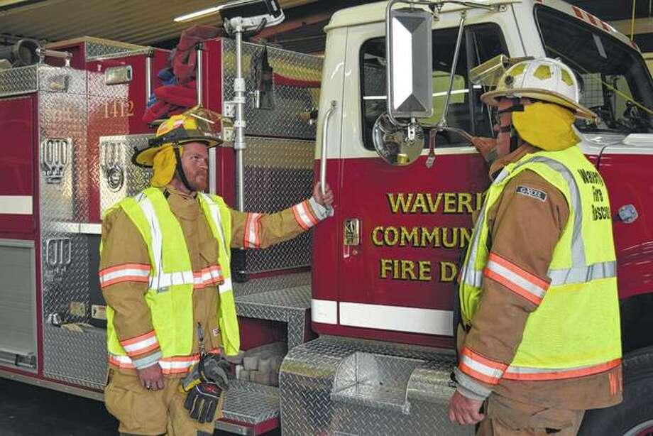 Waverly Volunteer Fire Department Lt. Mike Brown (left) speaks with his father, Fire Chief Glen Brown, at the fire station. The Browns said the fire department needs money to replace aging protective fire gear and trucks. Photo:       Greg Olson | Journal-Courier