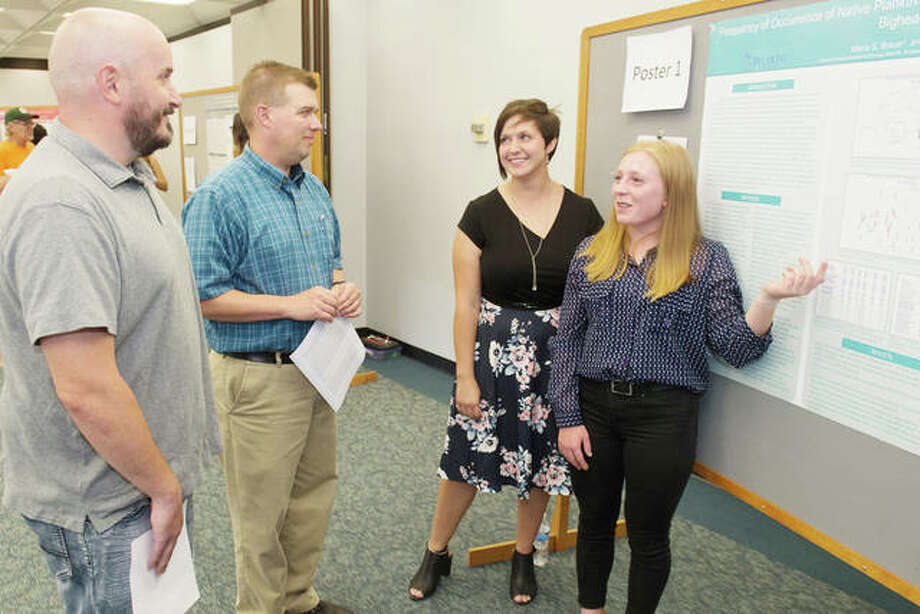 Maria Brauer, left, a rising junior from Belmont University, and Jennifer McBride, a rising junior from SIUE, present their findings at the REU Symposium. Photo:       For The Telegraph