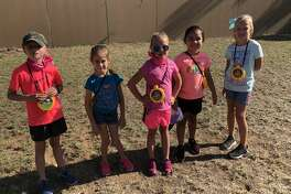 Girl Scouts: Lanie Burch, from left, Tatum Parker, Ryleigh Ramirez, Mila Ybarra and Bailey Brown