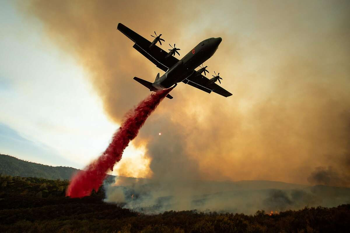 An air tanker drops retardant on the Ranch Fire, part of the Mendocino Complex Fire, burning along High Valley Rd near Clearlake Oaks, California, on August 5, 2018. Several thousand people have been evacuated as various fires swept across the state, although some have been given permission in recent days to return to their homes.