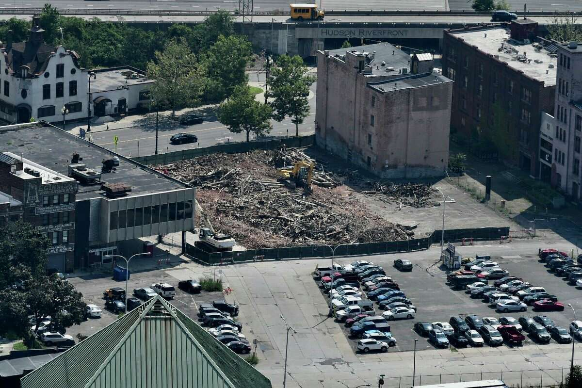 The property at 6 E-Comm Square in Albany is a giant pile of rubble on Monday, Aug. 6, 2018, following the building's emergency demolition. (Will Waldron/Times Union)