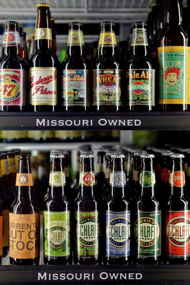 Microbrews on display in a cooler at the International Tap House in St. Louis, Missouri, on Nov. 9, 2010. Photo: Whitney Curtis/Bloomberg / Bloomberg