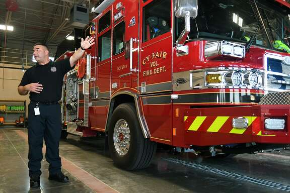 Capt. David Padovan, Cy-Fair Fire Dept. Public Information Officer, shows off part of the rolling stock at Station 13, the new station in the Bridgeland community.