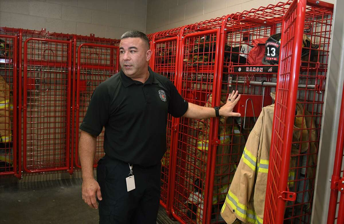Capt. David Padovan, Cy-Fair Fire Dept. Public Information Officer, shows off the equipment lockers for firefighters at Station 13, the new station in the Bridgeland community.