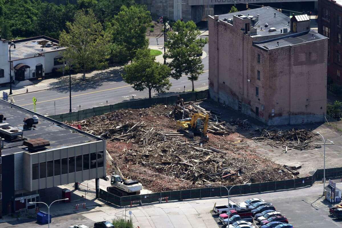 The remains of Six E-Comm Square fills the building's lot on Broadway on Monday, Aug. 6, 2018, in Albany, N.Y. The building was demolished last week after its roof collapse. (Will Waldron/Times Union)