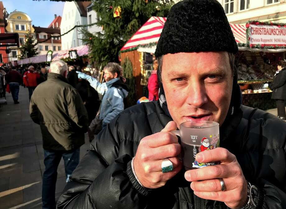 My partner Barkley Dean keeping the cold at bay with some warm gluhwein in Regensburg. He inherited the karakul hat from his grandfather, a Pan Am 747 pilot, which means travel runs deep in our family!  Photo: Chris McGinnis