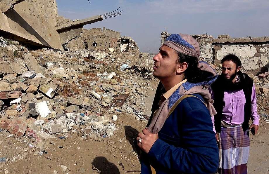 Former al Qaeda commander Harith al-Ezzi examines damage in Taiz in February. Many Al Qaeda members are fighting rebels. Photo: Associated Press