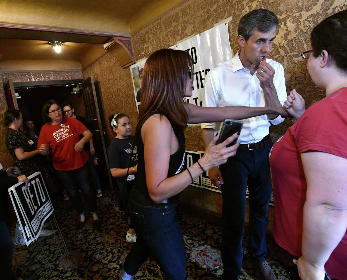 U.S. Senate candidate Beto O'Rourke listens to one of the attendees in the picture line after a town hall meeting Thursday, Aug. 2, 2018, at the Paramount Theatre in Abilene, Texas. Five Democratic candidates spoke to a crowd of nearly 800 people in this community known traditionally as a Republican stronghold.(Ronald W. Erdrich/The Abilene Reporter-News via AP)
