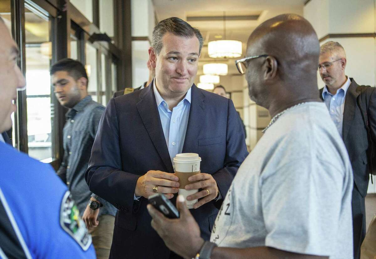 Sen.Ted Cruz chats with people at the Capitol Sheraton hotel in Austin on Aug. 4, 2018.