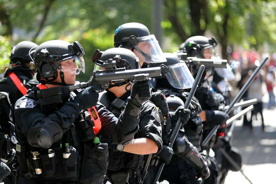 Police prepare to disperse protesters Saturday in Portland. Anti-fascist groups had gathered to protest a rally by extreme-right demonstrators. Photo: Mark Graves / The Oregonian