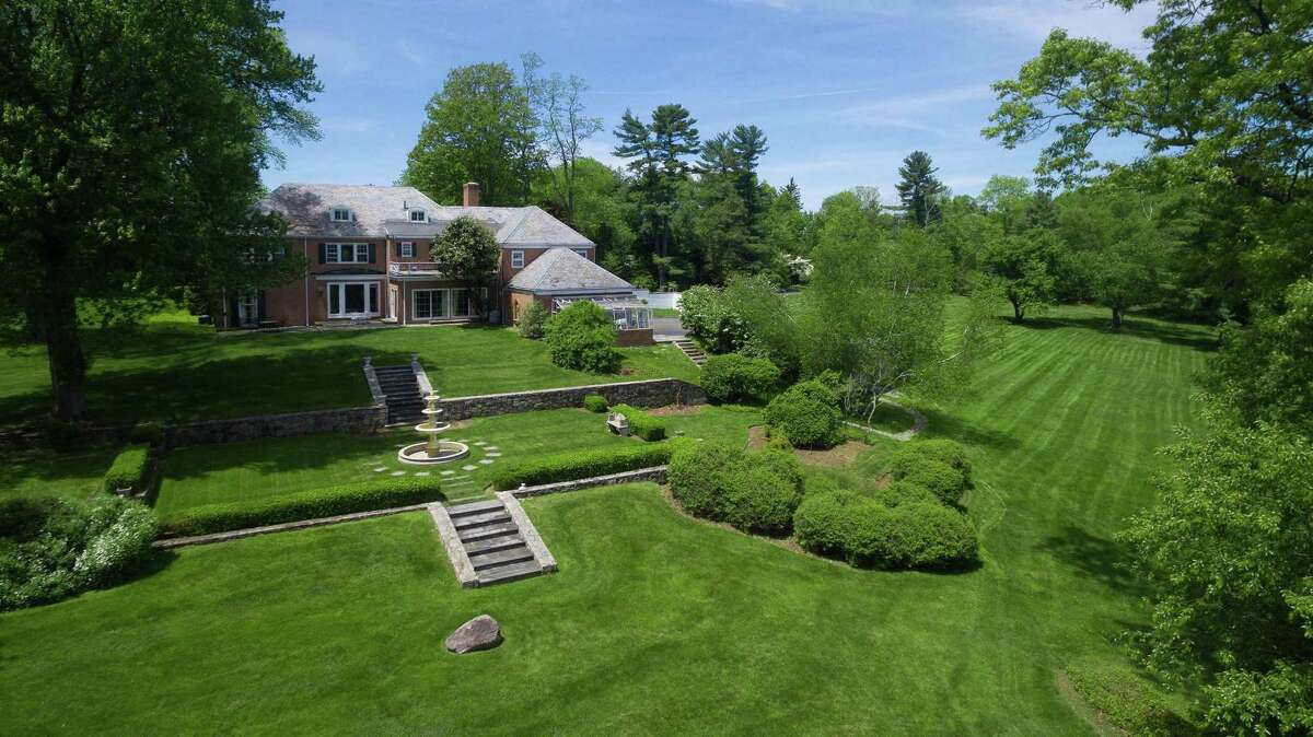 Part of the Khakum Wood Association in mid-country, Greenwich, 214 Clapboard Ridge Road comprises a five-bedroom colonial created by renowned architect Mott Schmidt, set up high on a nearly 8-acre lot. The property is listed for $7.595 million.