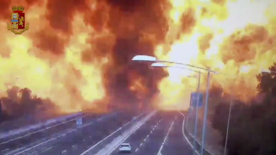 In this frame grab taken from a video released by the Italian police, the moment a truck that was transporting flammable substances explodes after colliding with another truck on a highway in the outskirts of Bologna, Italy, Monday, Aug. 6, 2018. The explosion killed at least two people and injured up to 70 as a section of the thoroughfare collapsed, police said. (Italian Police video via AP) Photo: Associated Press