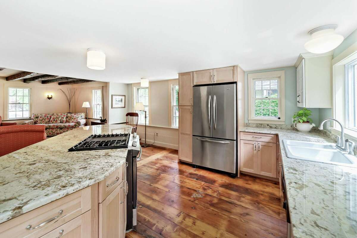 The stunning gourmet kitchen at 111 North St. in Milford features wide plank flooring and a center island. The Sanford Bristol House is listed on The National Register of Historic Places and has been restored and updated by the current owner.