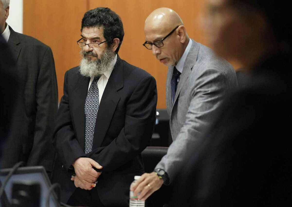 In this June 25, 2018 photo, Ali Mahwood-Awad Irsan, left, stands in court with his defense attorney Rudy Duarte, right, in Houston. Irsan, a 60-year-old Jordanian-American, is charged with capital murder, accused of killing his daughter?'s husband and her best friend, an Iranian activist. (Melissa Phillip/Houston Chronicle via AP)